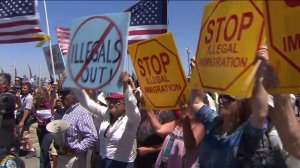 About 100 to 150 people protested the arrival of 140 undocumented immigrants in Murrieta on July 1, 2014. (Credit: KTLA)