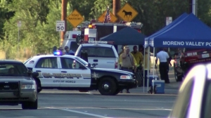 The Riverside County Sheriff's Department responded in force during a search for one or two people in Moreno Valley on July 22, 2014. (Credit: KTLA)