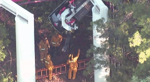 Firefighters survey what appeared to be a derailed train on the Ninja ride. (Credit: KTLA)