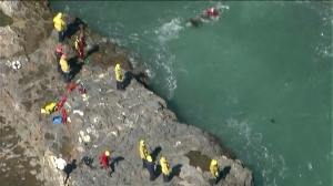 Divers were searching Wednesday for a swimmer missing off the coast of Palos Verdes. (Credit: KTLA)