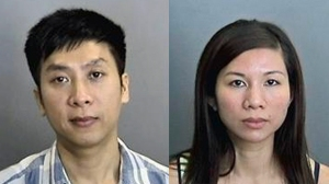 Loi Vu, 40, (left) and Tracy Trang Le, 35, were booked on suspicion of felony child endangerment and false imprisonment. (Credit: Anaheim Police Department)