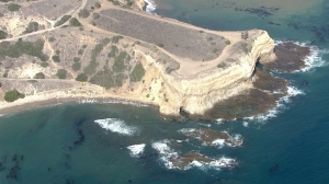 Treacherous conditions at Sacred Cove and Abalone Cove, at left, prompted multiple rescue efforts in early July 2014. (Credit: KTLA)