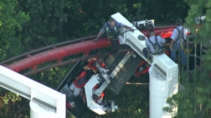 Rescuers worked to help passengers off the Ninja roller coaster at Magic Mountain July 7, 2014. (Credit: KTLA)