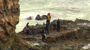 Divers and rescuers searched the Inspiration Point area for missing swimmer Joseph Sanchez on July 10, 2014. (Credit: KTLA)