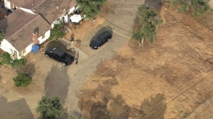 Authorities were responding to the scene where a young boy was trapped in a hot vehicle in Sylmar on July 30, 2014. He later died. (Credit: KTLA)
