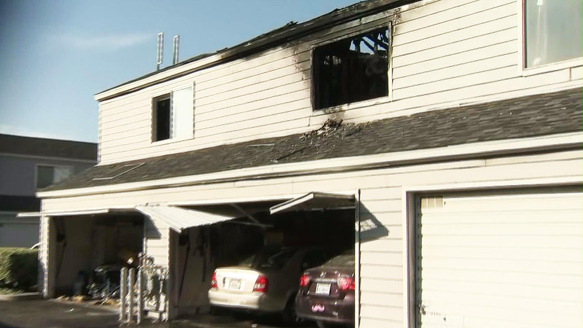 Flames erupted at a condominium in Sylmar Monday morning. (Credit: KTLA)