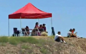 Family members watched the search effort for missing teen swimmer Joseph Sanchez on July 10, 2014, in Rancho Palos Verdes. (Credit: KTLA)