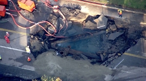 After a water-main break on Sunset Boulevard, crews worked to make repairs on Wednesday, July 30, 2014. (Credit: KTLA)