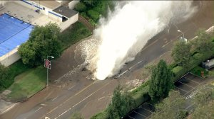A water main break in Westwood sent a geyser gushing into the air and across the UCLA campus on July 29, 2014. (Credit: KTLA)