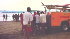 Video posted to Instagram showed lifeguards loading a person into a lifeguard vehicle after a lightning strike on July 27, 2014.
