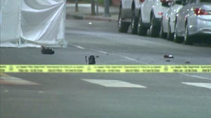 A police vehicle responding to a scene in West Adams struck and killed a naked man who was wearing only tennis shoes and lying on a street on July 27, 2014. (Credit: KTLA)