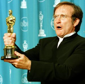 "Actor Robin Williams is showing holding the Oscar he won for Best Supporting Actor for his role in ""Good Will Hunting"" during the 70th Annual Academy Awards 23 March, 1997, in Los Angeles. (Credit: HAL GARB/AFP/Getty Images)"