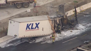 A big rig caught fire on the 5 Freeway in Santa Fe Springs, prompting the closure of all southbound lanes ahead of the morning commute on Aug. 1, 2014. (Credit: KTLA)