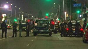 LAPD responds to the scene were police fatally shot a man on Aug. 11, 2014. (Credit: KTLA)