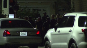 """A """"person of interest"""" wanted in connection with a deadly shooting spree in the San Fernando Valley was detained following a barricade on Aug. 24, 2014. (Credit: KTLA)"""