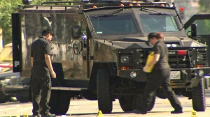 A SWAT armored truck helped save officers in a shootout on Aug. 18, 2014. (Credit: KTLA)