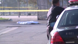 Police responded to a second shooting on Aug. 24, 2014, that left a 29-year-old man dead in Sylmar. (Credit: OnSceneTV)