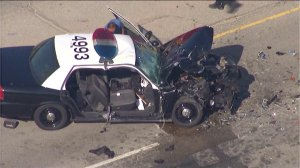 Two officers were injured when a Los Angeles school police vehicle collided with a dump truck in Sun Valley on Aug. 1, 2014. (Credit: KTLA)