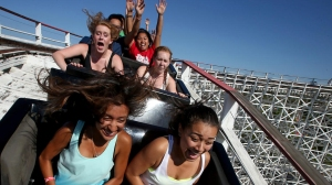 Riders head toward one of two high drops aboard the Colossus roller coaster at Six Flags Magic Mountain. (Credit: Los Angeles Times)