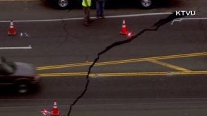 A large crack was visible in a Napa Valley County road following a large quake on Aug. 24, 2014. (Credit: KTVU)