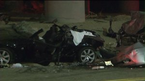 Street racing was suspected in a car crash that left two people dead and three others injured, according to LAPD. (Credit: KTLA)
