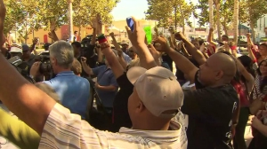At a peaceful protest in Leimert Plaza Park, hundreds raised their hands during a moment of silence for Mike Brown on Aug. 14, 2014. (Credit: KTLA)