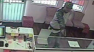 Surveillance video provided by the store owner of an apparent armed robbery in Hawthorne on Tuesday, Aug. 12, 2014.