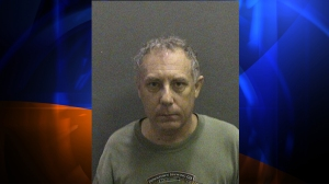 Orange County piano teacher John Mordecai Scott, 58, was arrested on suspicion of lewd and lascivious conduct with a child, authorities said. (Credit: Orange County Sheriff's Department)