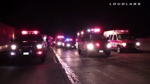 Three people were injured during a shooting on the 60 Freeway in Jurupa Valley on Aug. 16, 2014. (Credit: Loudlabs)