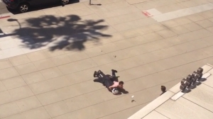 A witness captured cellphone video of an altercation that sent an LAPD motor officer to the hospital on Aug. 5, 2014.