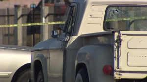 A man's body was found in a vehicle with shattered windows in Pacoima on Aug. 21, 2014. (Credit: KTLA)