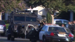 A SWAT team responded after a man barricaded himself inside a home on Aug. 1, 2014, according to the L.A. County Sheriff's Department. (Credit: KTLA)