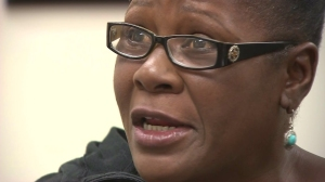 Marlene Pinnock was repeatedly punched on July 1, 2014, by a CHP officer in an incident caught on cellphone video. She speaks during an interview here on Aug. 20, 2014. (Credit: KTLA)