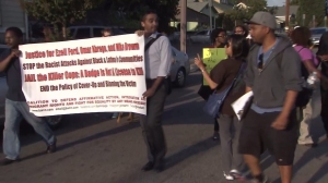 Protesters demanding justice in the deaths of Ezell Ford and Omar Abrego held a march in South L.A. on Aug. 19, 2014. (Credit: KTLA)
