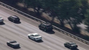 Authorities were in pursuit of a black SUV in the San Fernando Valley on Monday, Aug. 25, 2014. (Credit: KTLA)