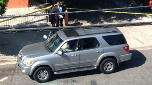 A resident's photo shows a damaged SUV after a shooting occurred in the 1400 block of Celis Street on Sunday, Aug. 24, 2014.