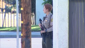 A Sheriff's Department deputy responds after a gunman fired shots at Long Beach police officers on Aug. 27, 2014. (Credit: KTLA)