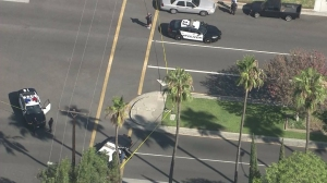 """San Fernando police had blocked off streets where a """"suspect"""" was shot by police on Aug. 12, 2014. (Credit: KTLA)"""