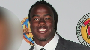 USC football player Josh Shaw attends a Los Angeles Fire Department Foundation event in Sherman Oaks April 5, 2014. The woman next to him has been blurred. (Credit: David Buchan/Getty Images)