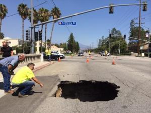 Inspectors were responding a sinkhole that opened up Aug. 4, 2014, in Redlands. (Credit: San Bernardino Sun)