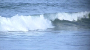 A rare high surf with waves of 10 to 15 feet was expected for several days at Southern California beaches beginning Tuesday, Aug. 26, 2014. (Credit: KTLA)