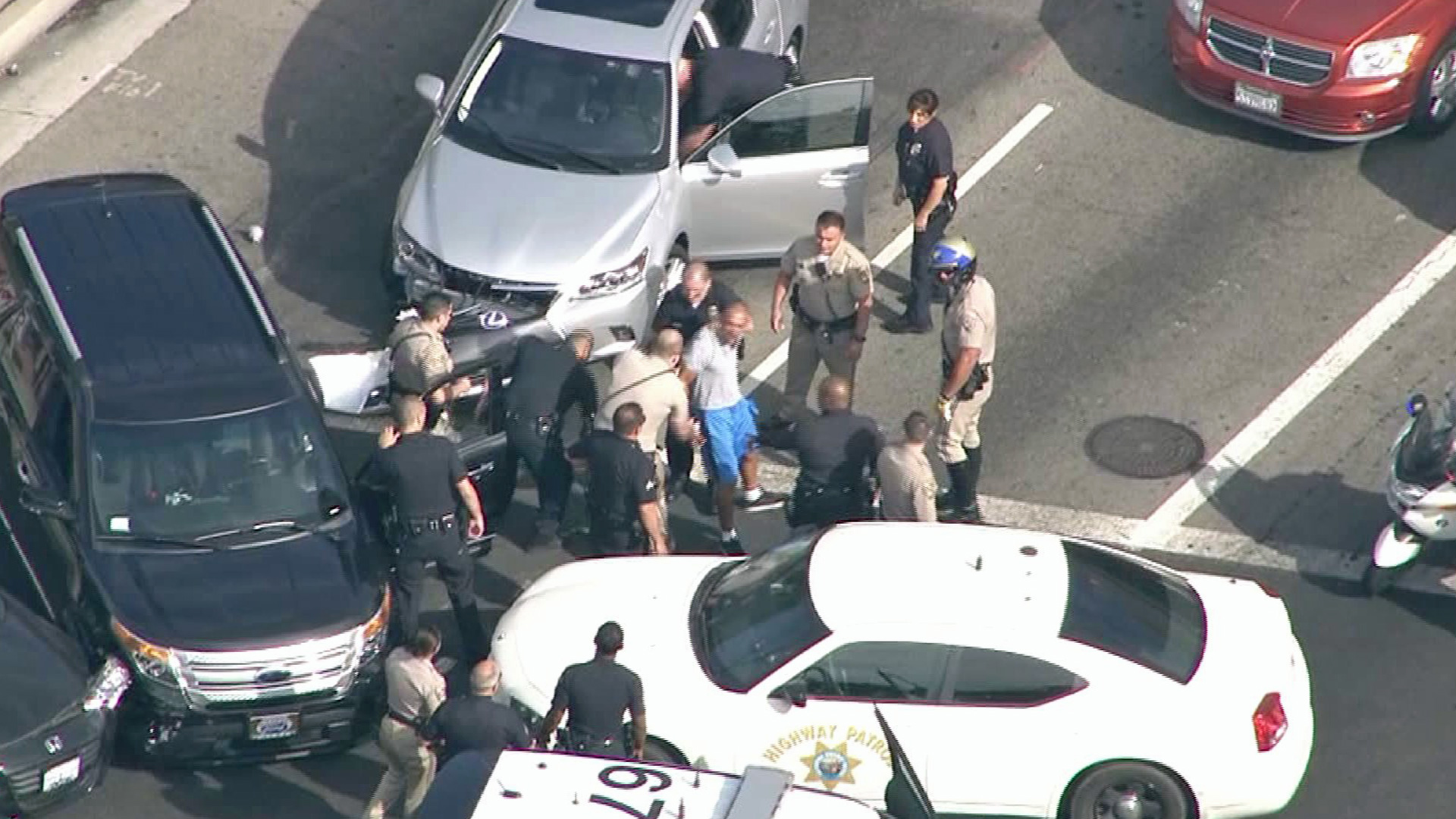 A man was taken into custody following a pursuit in the San Fernando Valley on Monday, Aug. 25, 2014. (Credit: KTLA)