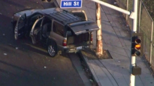 The SUV was abandoned by the two suspects at 37th and Hill streets. (Credit: KTLA)