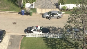 A second vehicle that was carjacked was left in front of the site of a home invasion on Aug. 11, 2014. (Credit: KTLA)