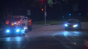 The first car heads through newly reopened Sunset Boulevard early Aug. 4, 2014. (Credit: KTLA)