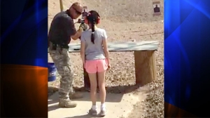 Charles Vacca, an instructor at a shooting range in White Hills, Ariz., showed a 9-year-old girl how to use an Uzi in this still from a video of the fatal lesson on Aug. 26, 2014. (Credit: Mohave County Sheriff's Department)