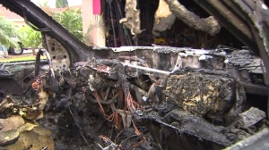 Four Santa Ana residents were displaced after a fire broke out in a vehicle and spread to others and a garage before being extinguished on Aug. 31, 2014. (Credit: KTLA)