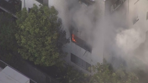 Firefighters were responding to a blaze at an apartment building in West Hollywood on Thursday, Sept. 18, 2014. (Credit: KTLA)