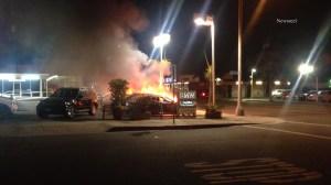 Five cars were set on fire at a Santa Monica BMW dealership on Sept. 10, 2014. (Credit: Newsreel)