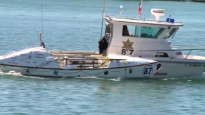 A vessel described as a professional rowboat was towed back to Newport Beach on Wednesday, Sept. 17, 2014. (Credit: KTLA)